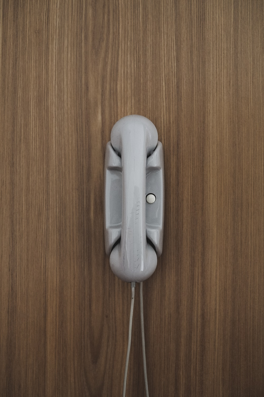 gray home phone on wall