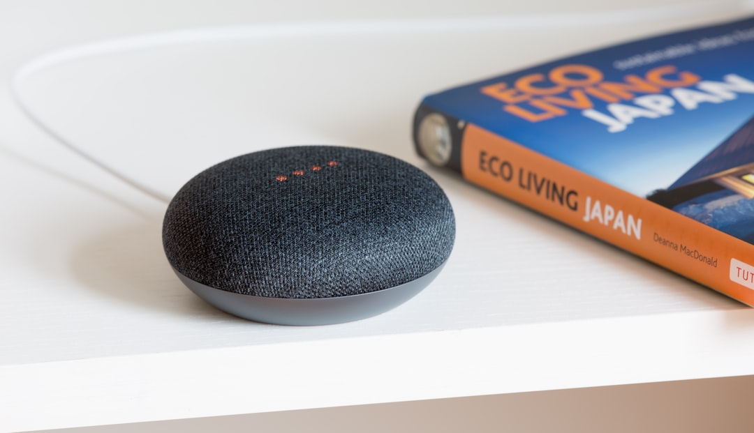 charcoal Google Mini on white surface
