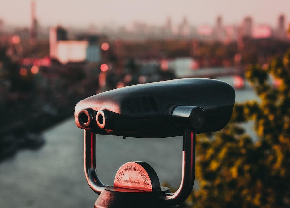 black binoculars fronting building