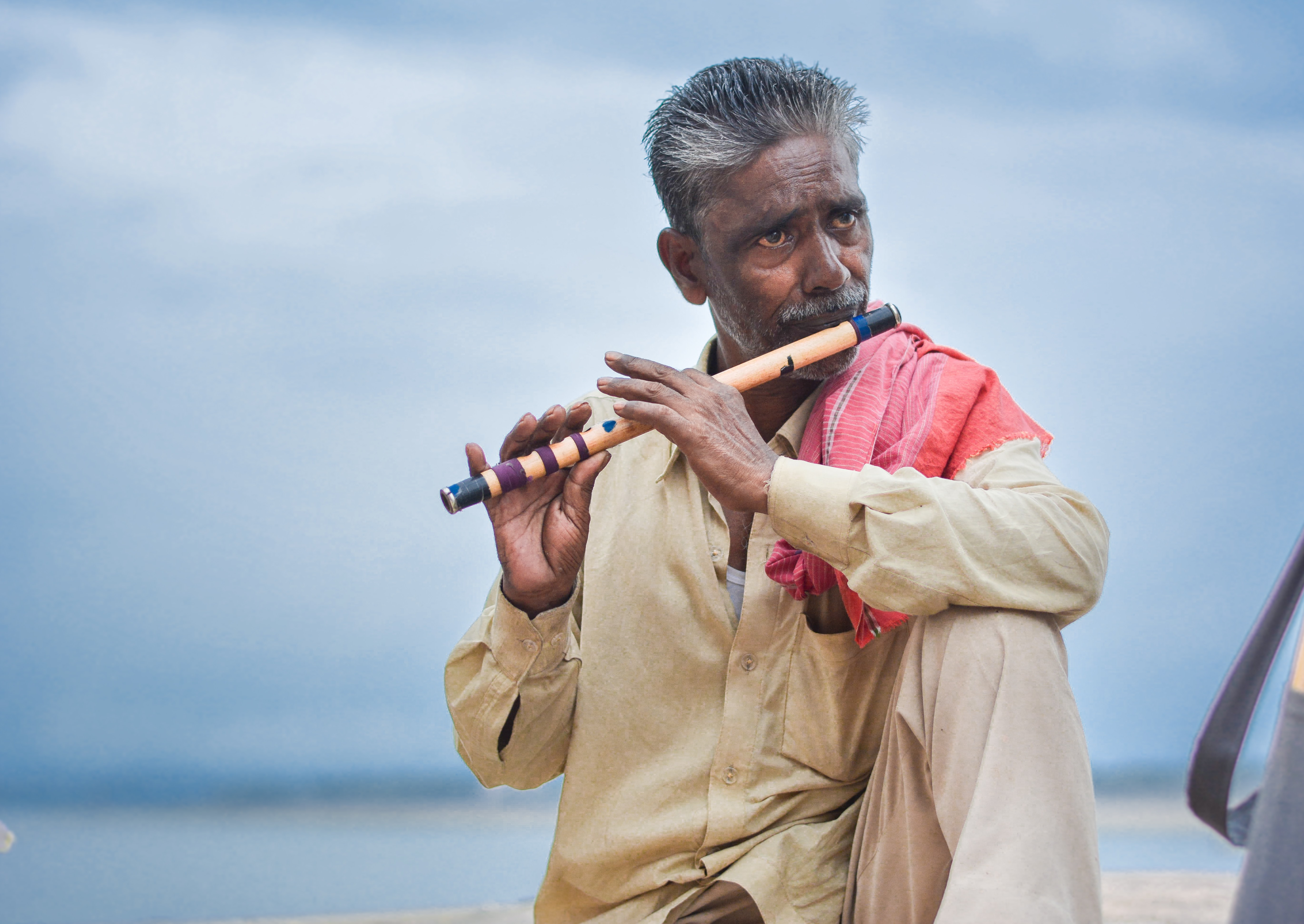 man playing flute outdoor
