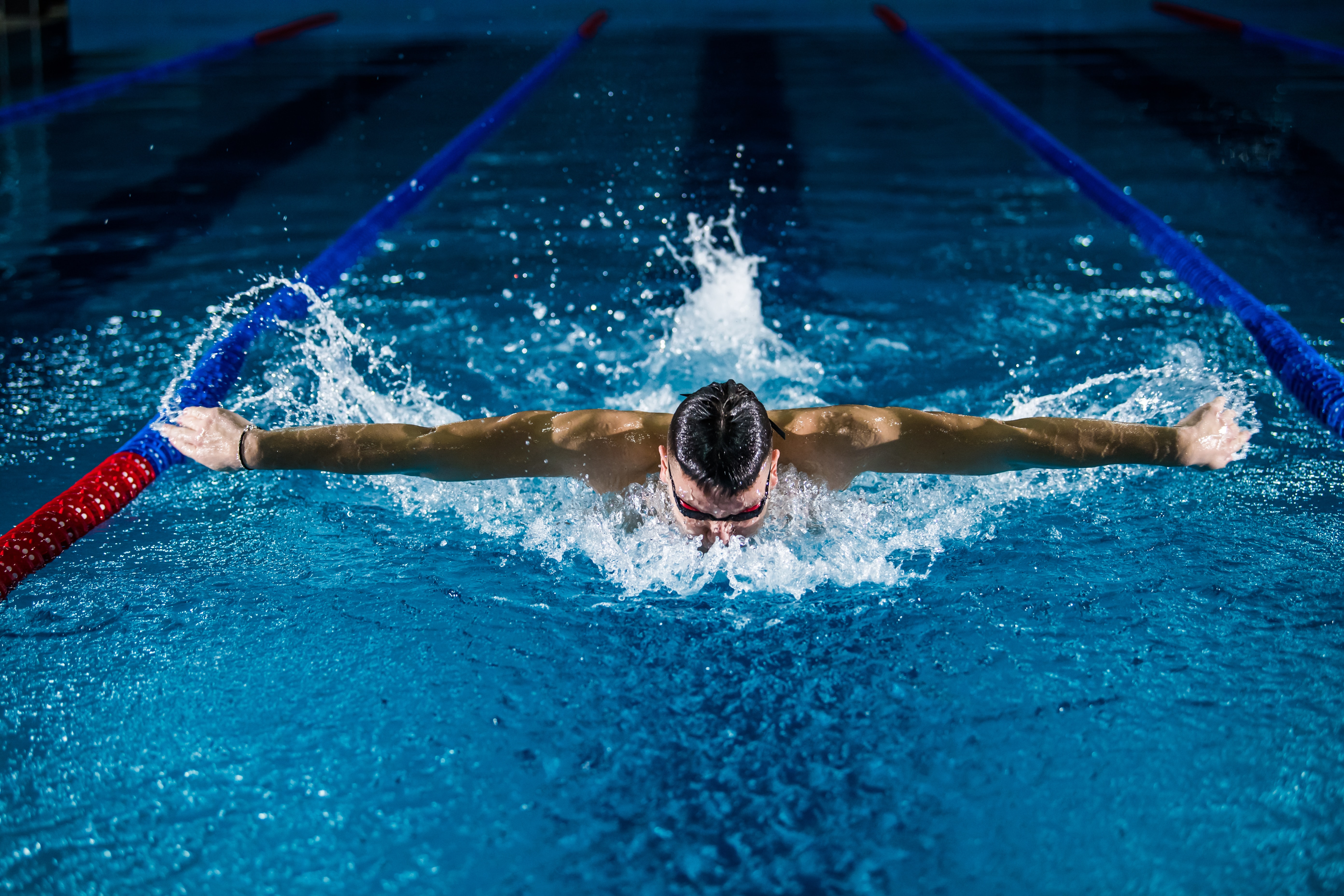 man doing butterfly stroke