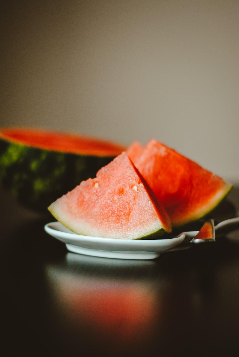watermelon slice on white ceramic plate