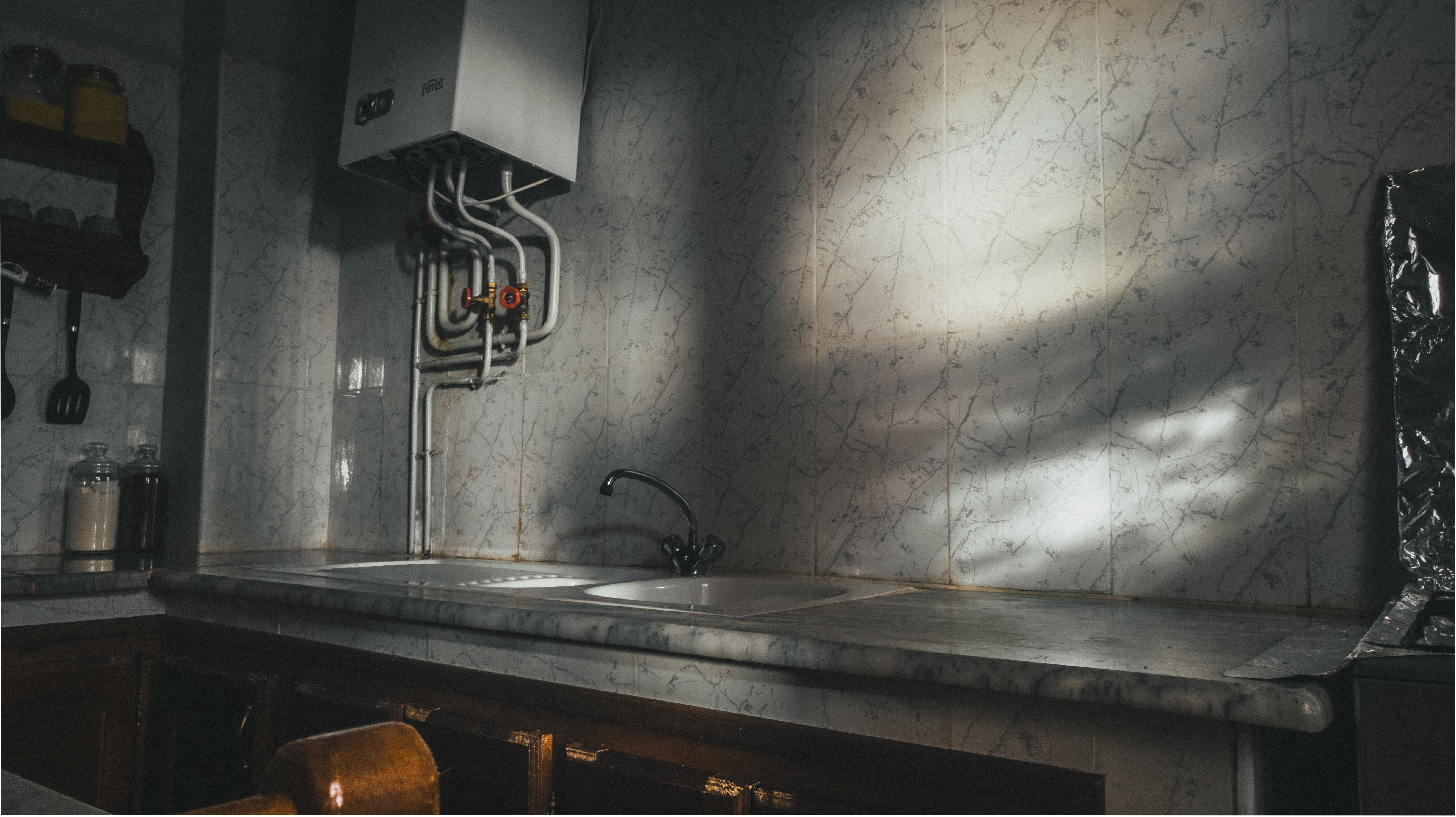 gray stainless steel sink with faucet
