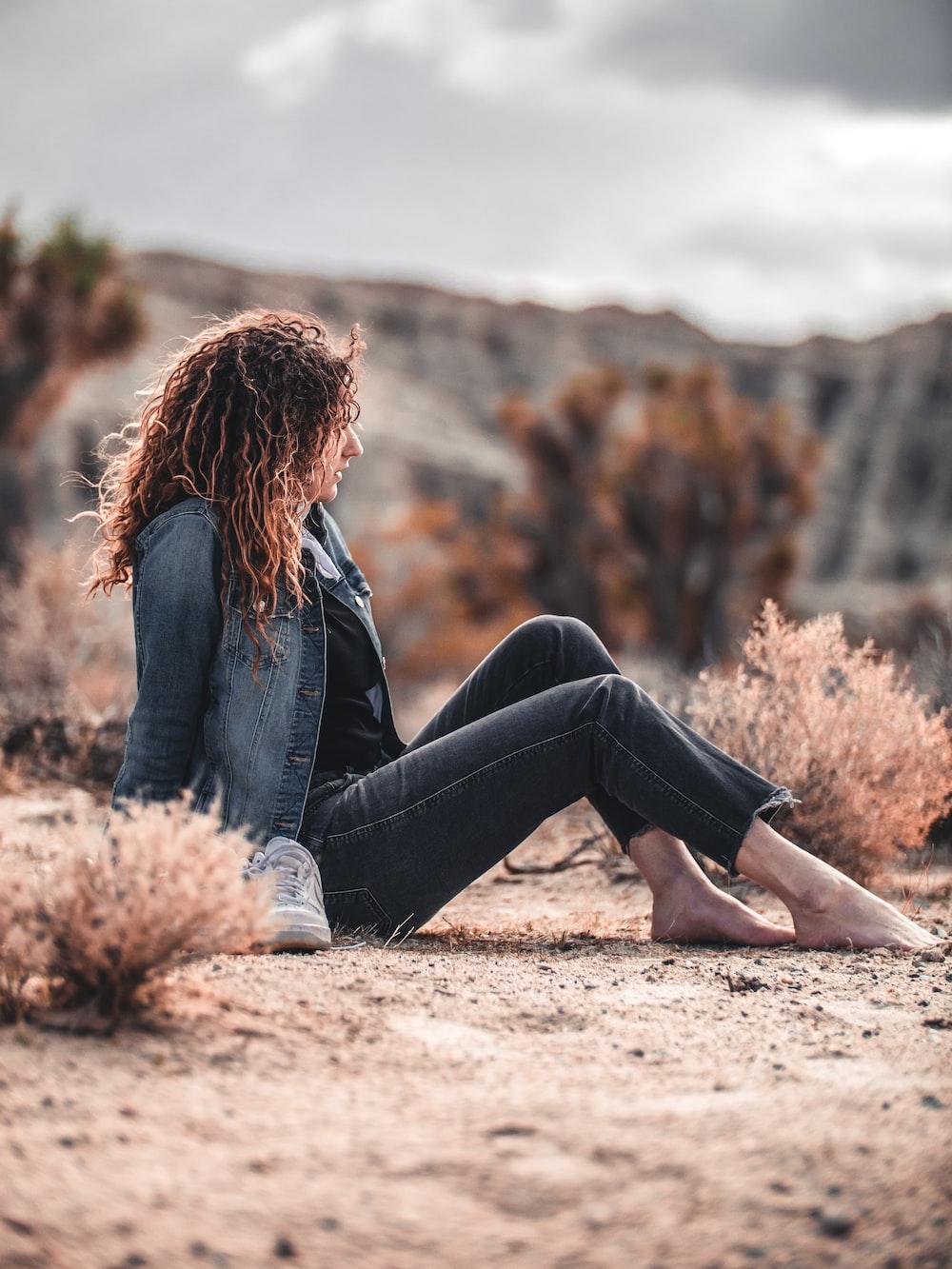 woman sitting on brown soil