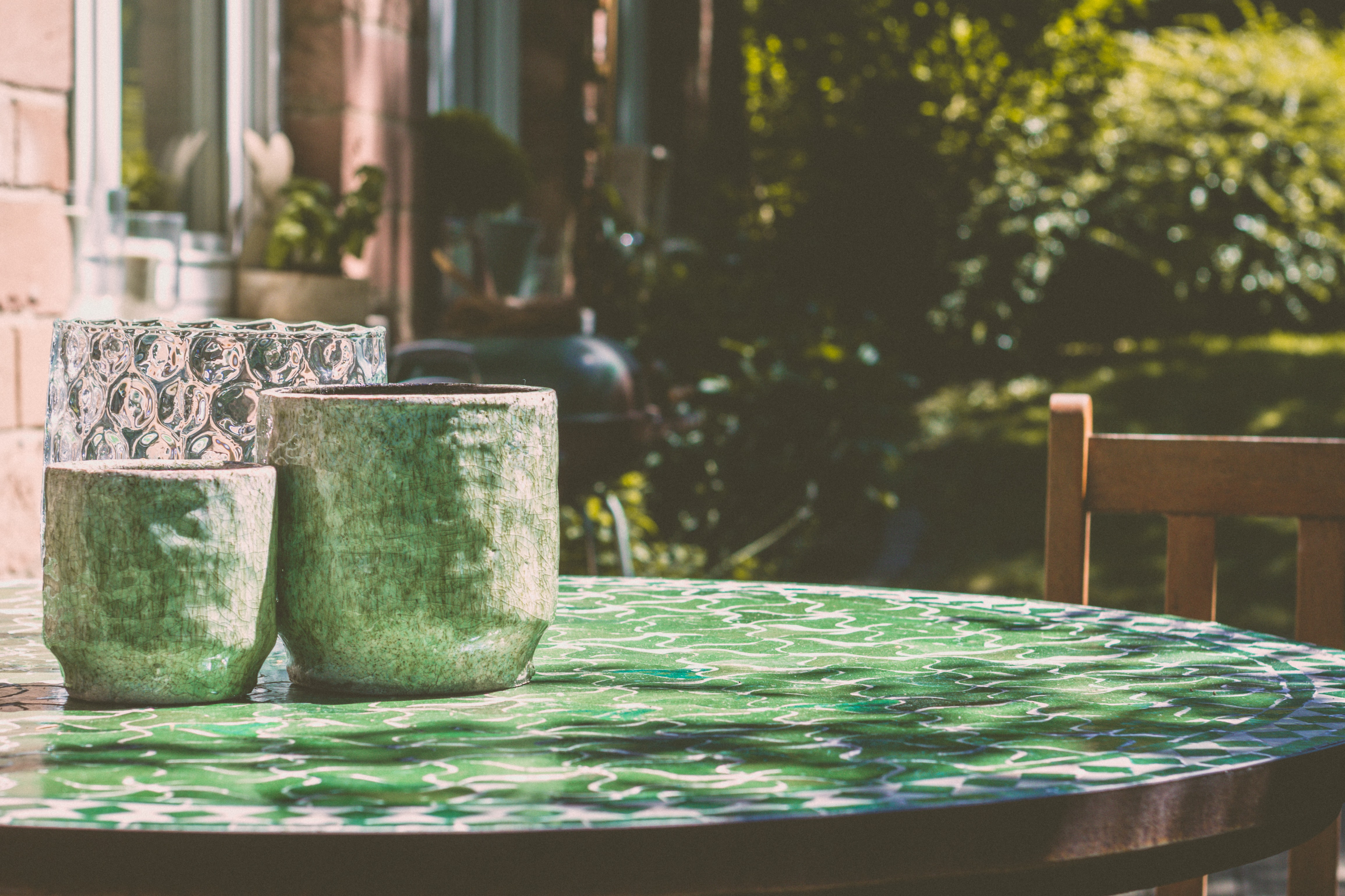 selective focus photography of vases on table