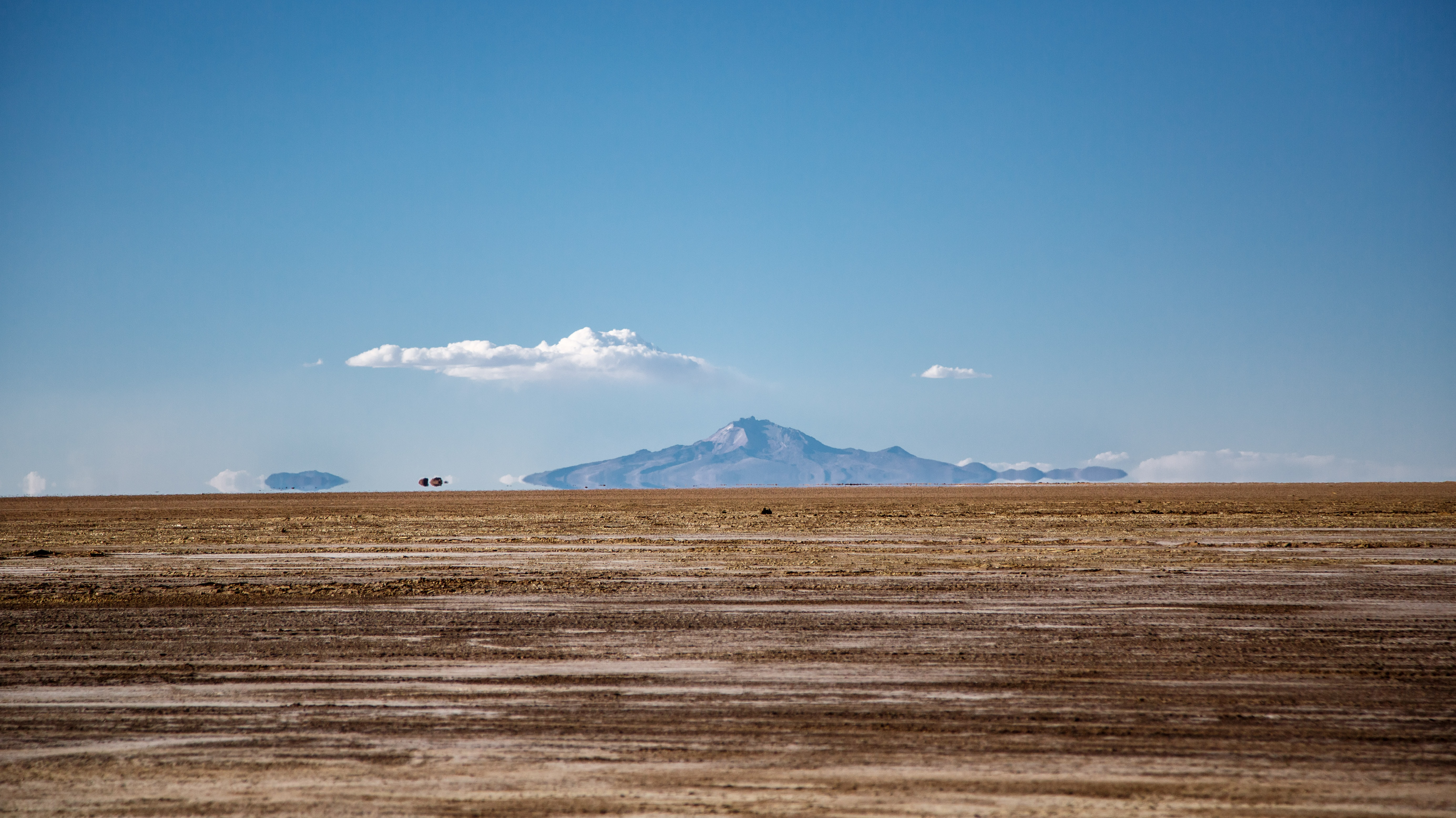 mountain across brown desert