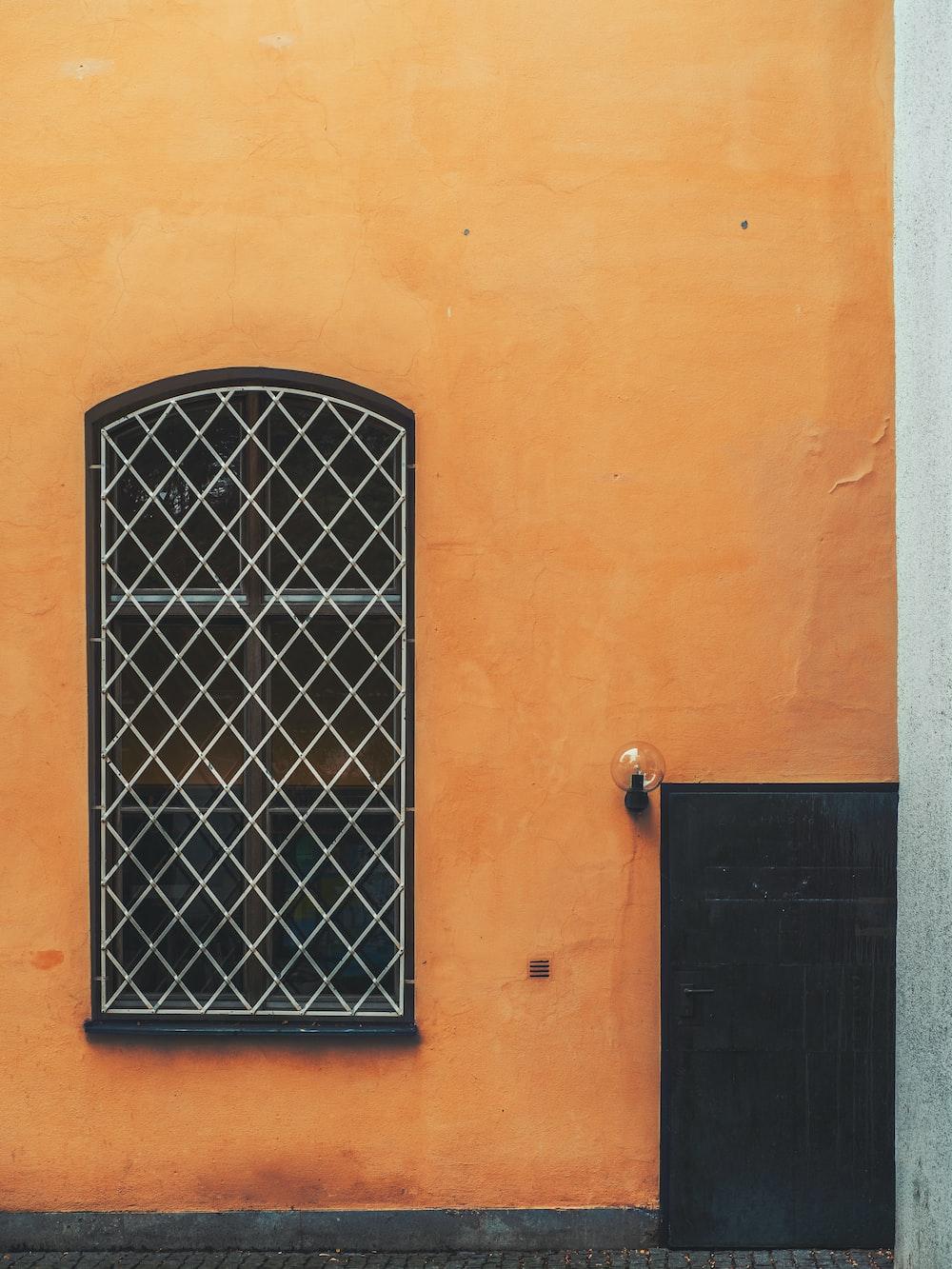 closed black door and window