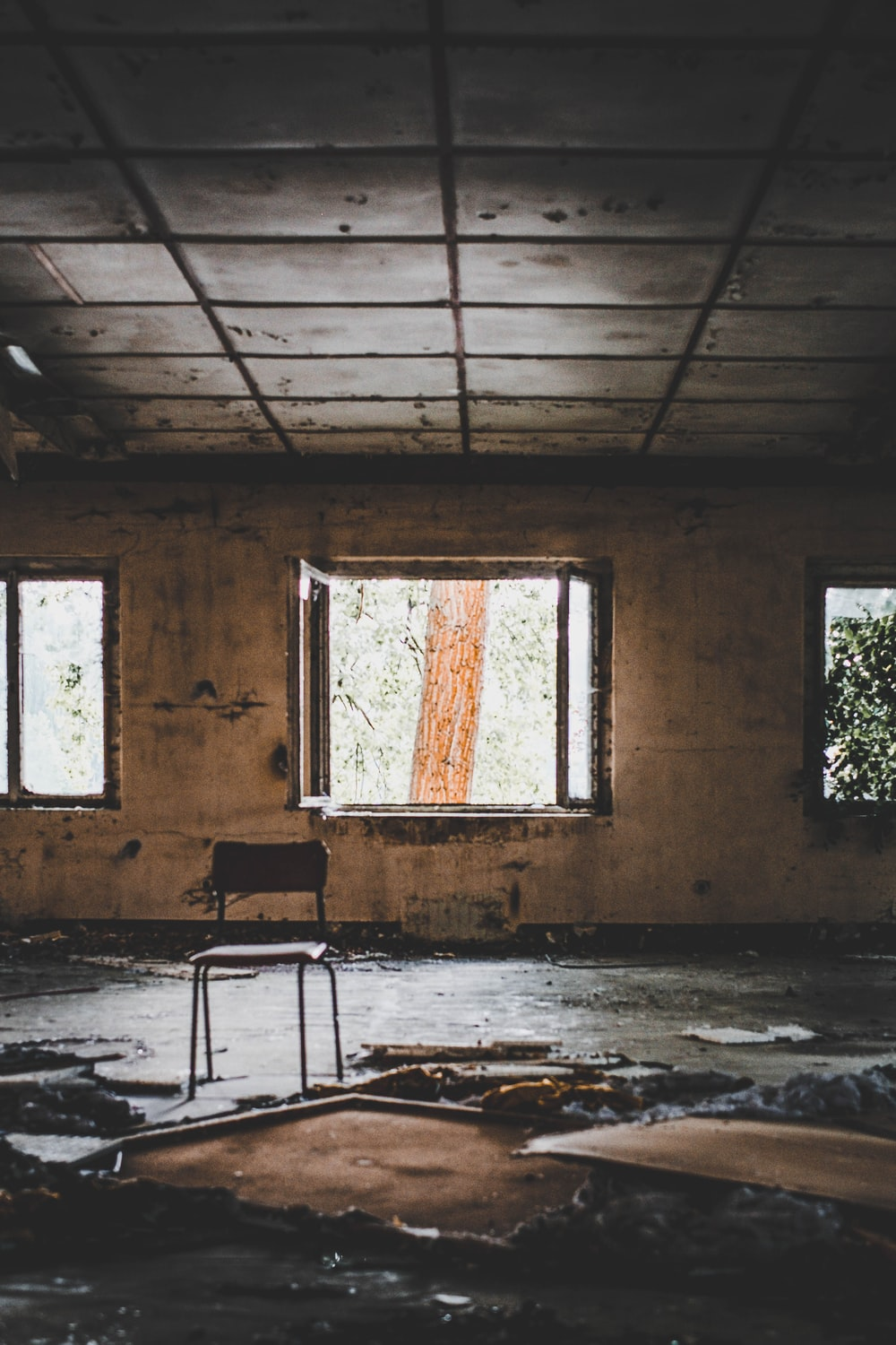 brown chair in abandoned house