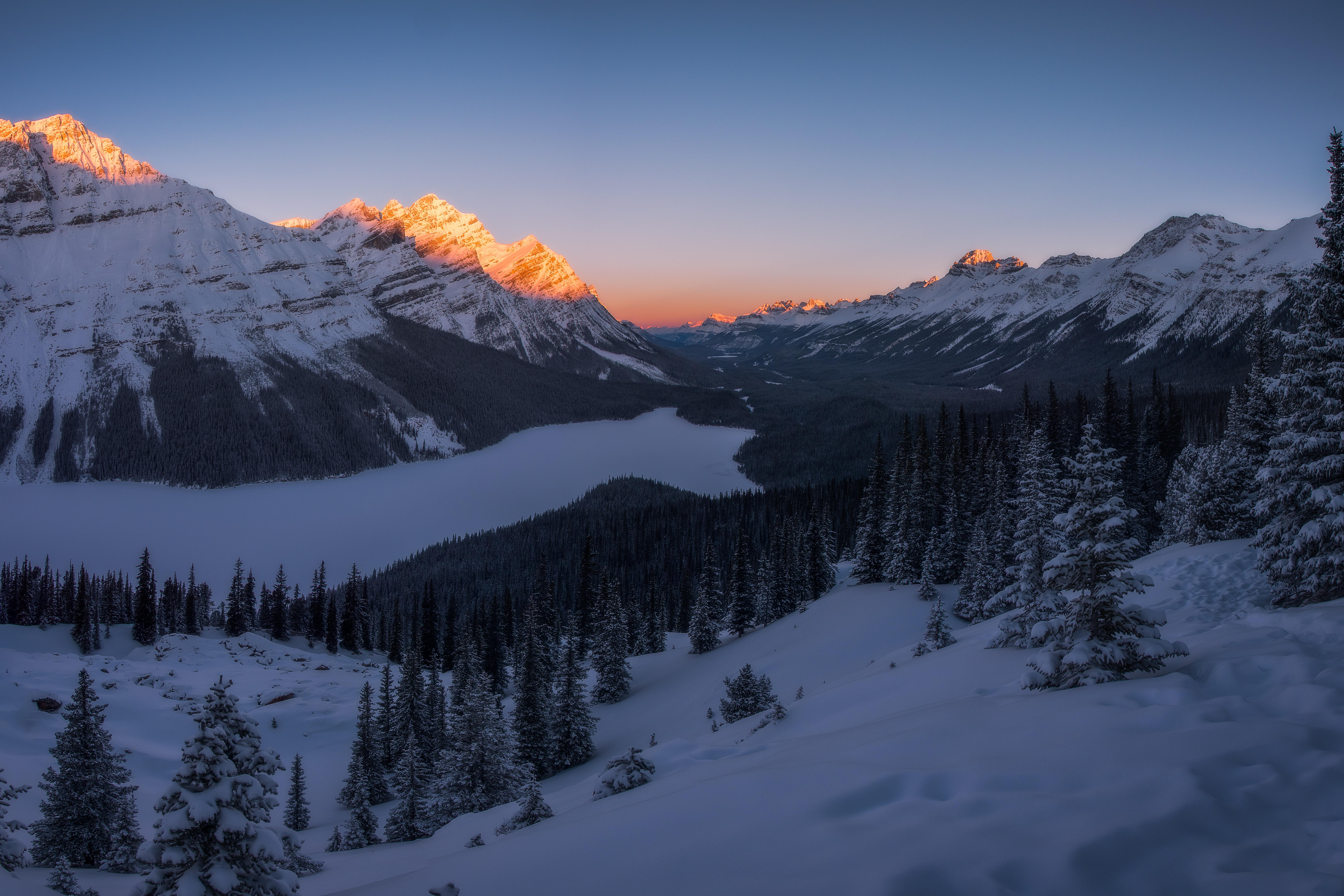 landscape shot of snowy mountain under blue sky
