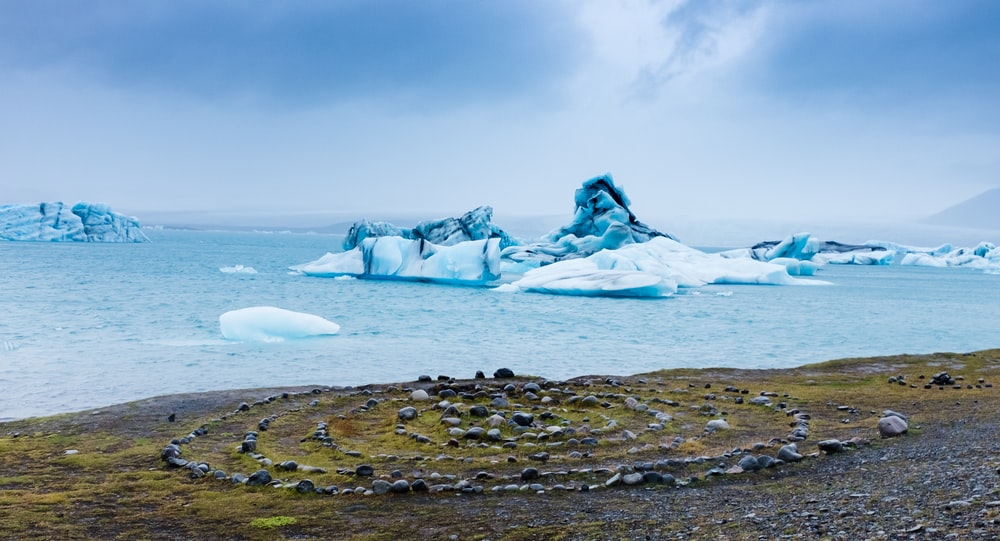 body of water and ice bergs