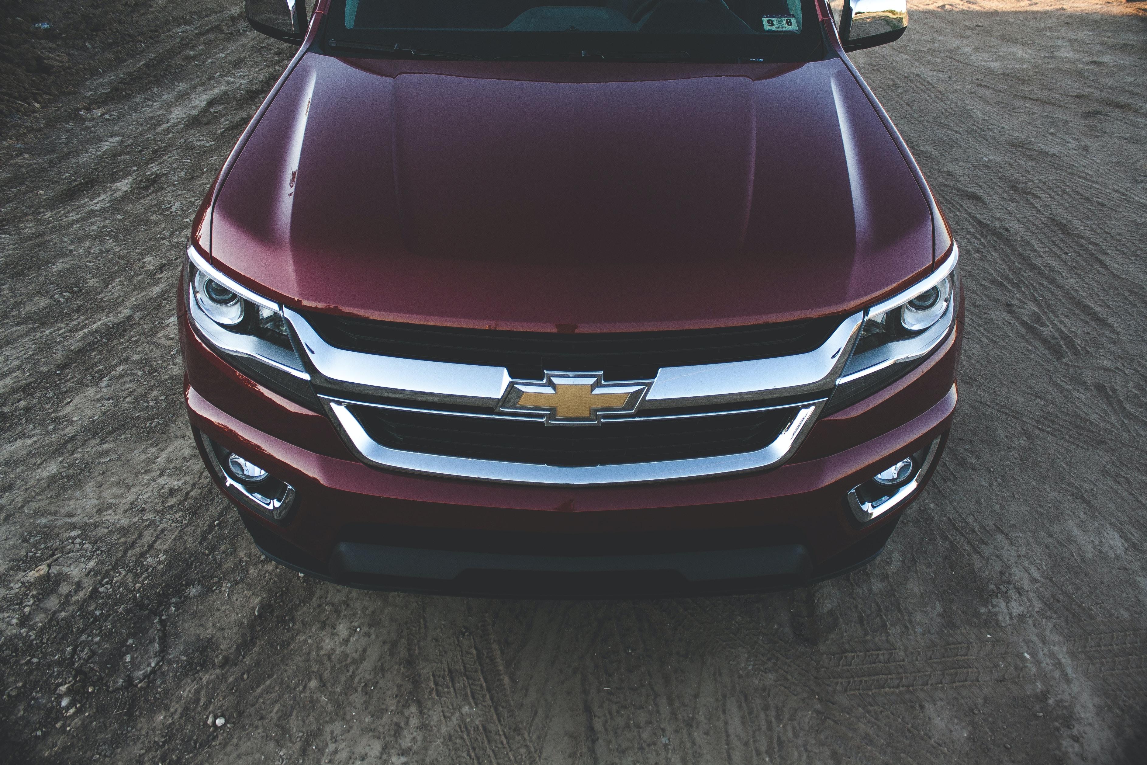 maroon Chevrolet vehicle in closeup photo