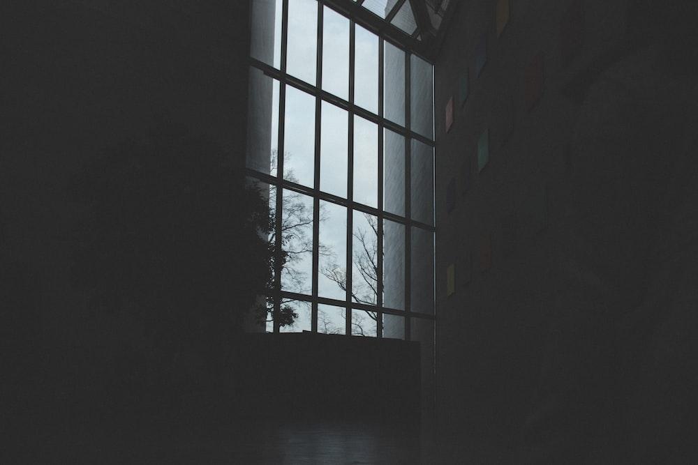 gray wooden framed window inside building