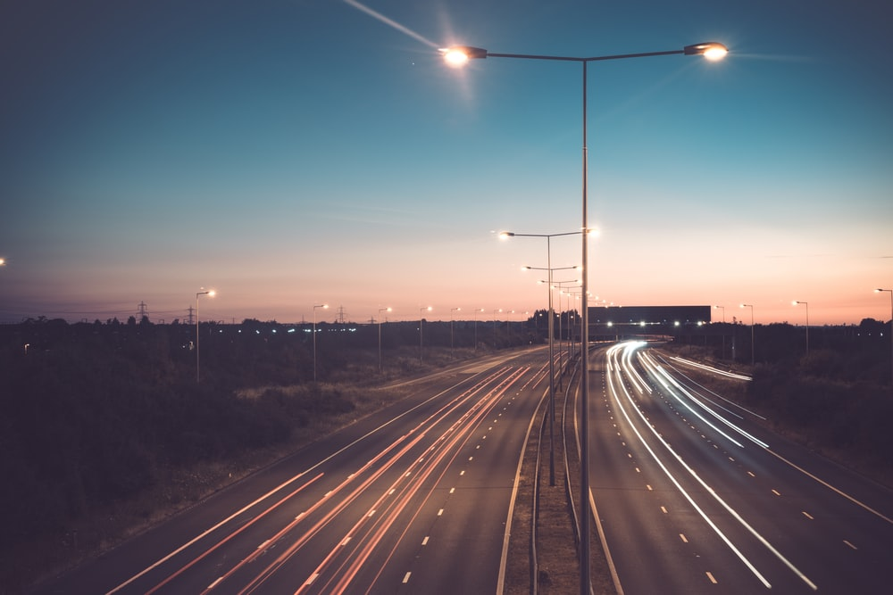 time-lapse photography of road during blue hour