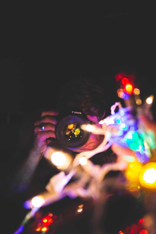woman taking bokeh effect photo