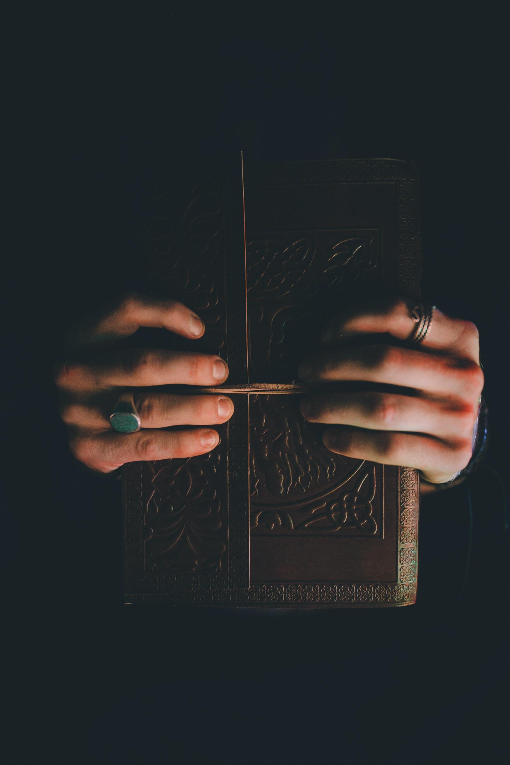 person holding hardbound book