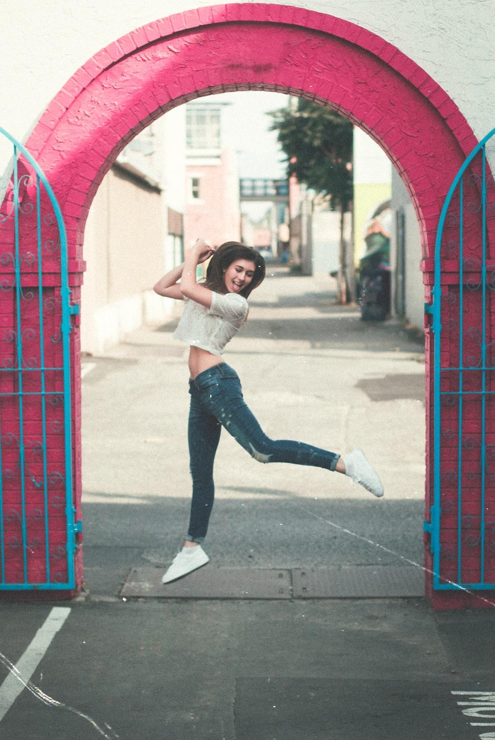 woman jumping near gate