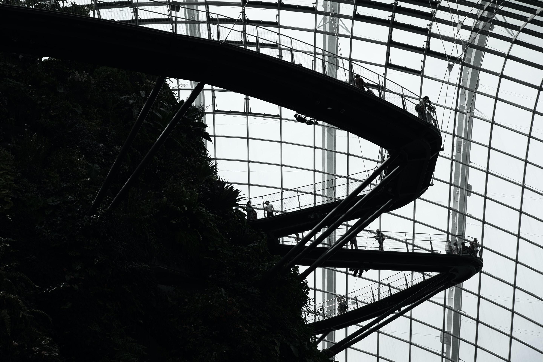 photo of silhouette roller coaster rails indoor