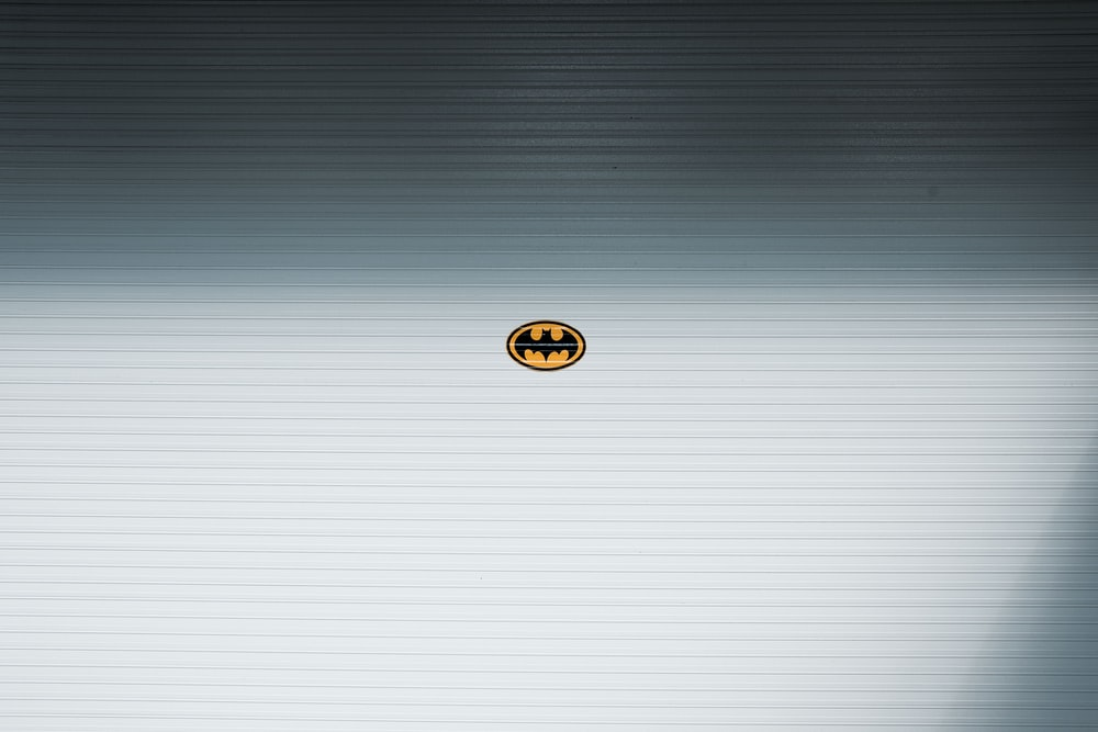Batman logo placed on white surface