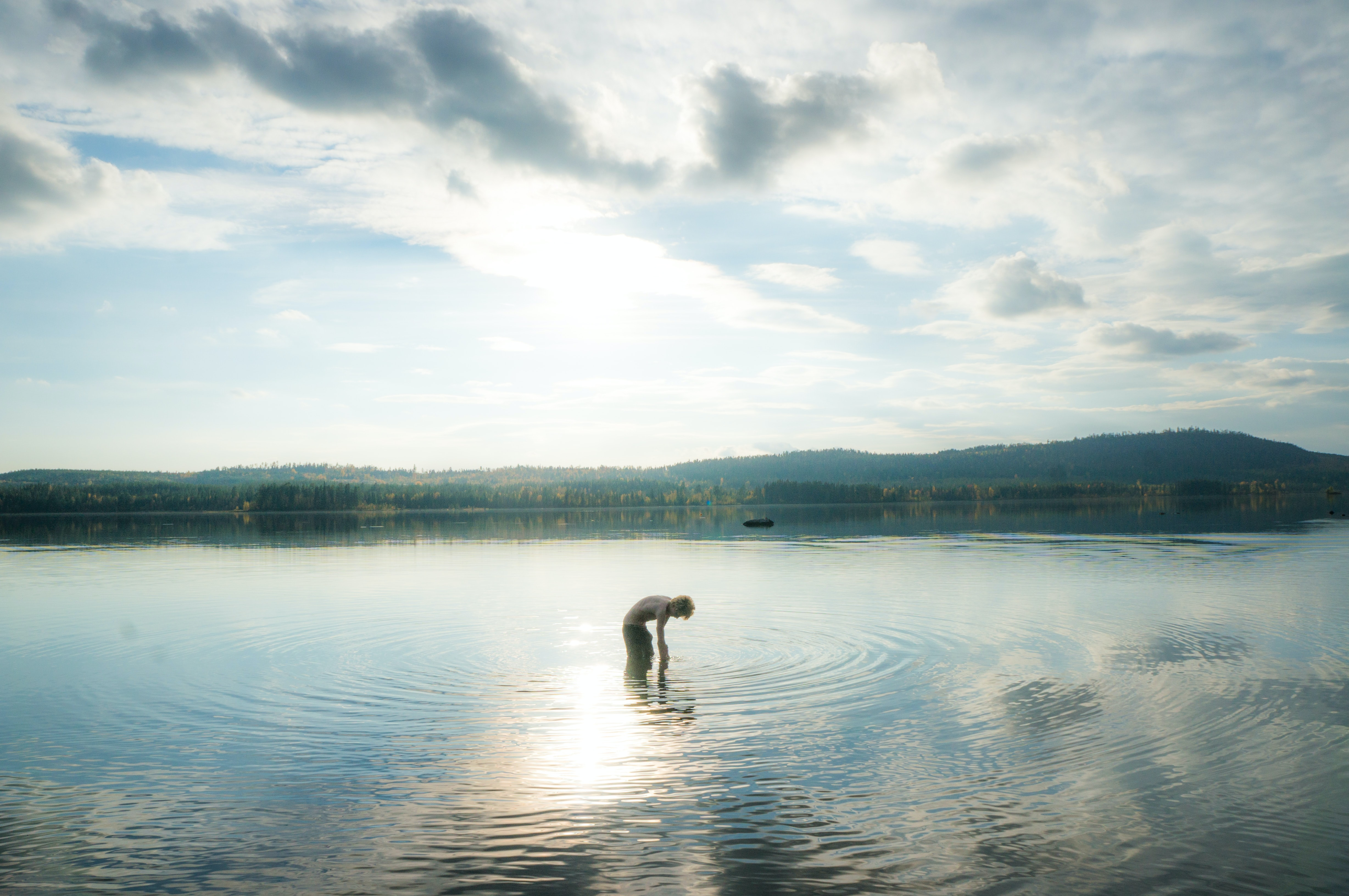 person standing on body of water