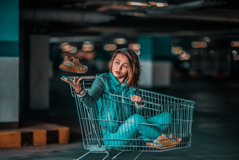 woman sitting on gray shopping card