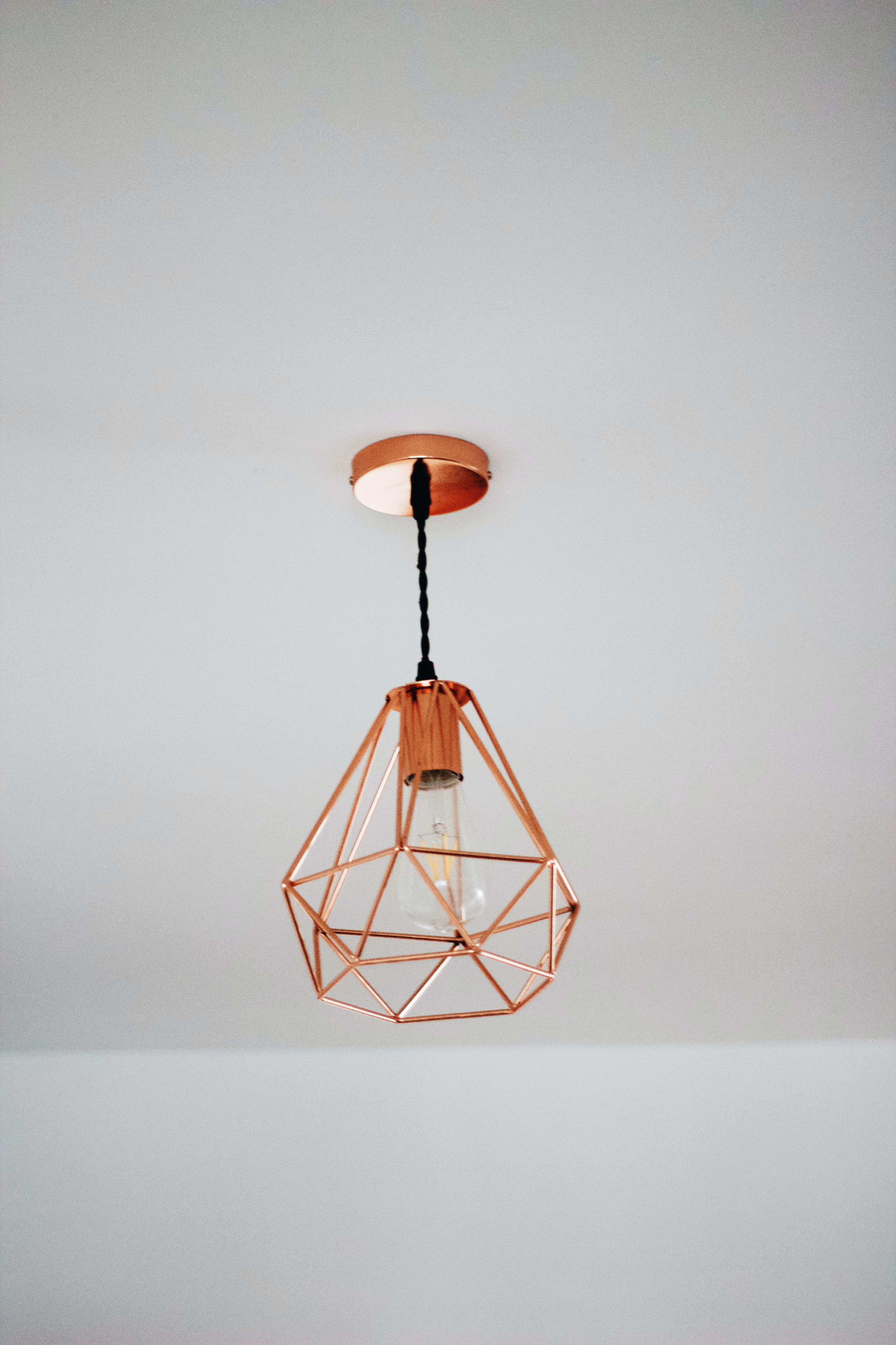 brown pendant lamp on ceiling