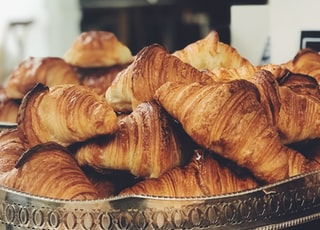 croissant on top of stainless steel tray