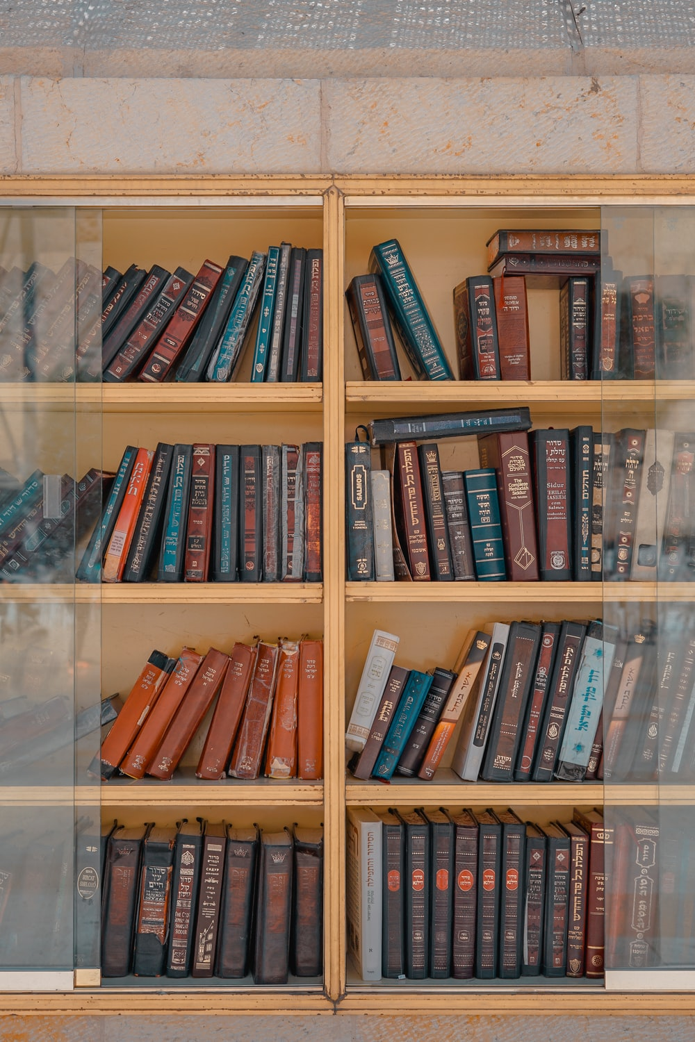 assorted-title books placed on shelf