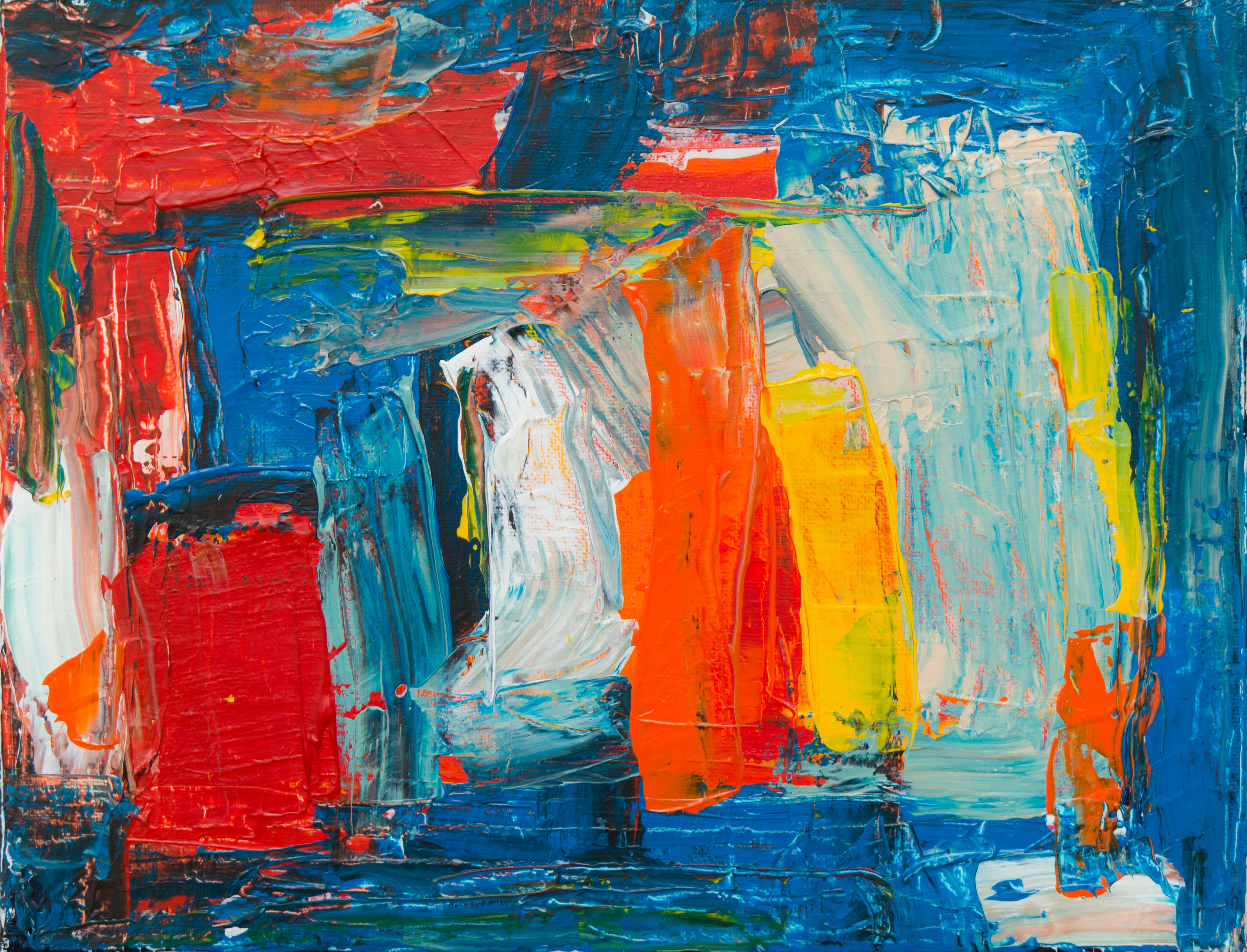 red, yellow, white, and blue abstract painting