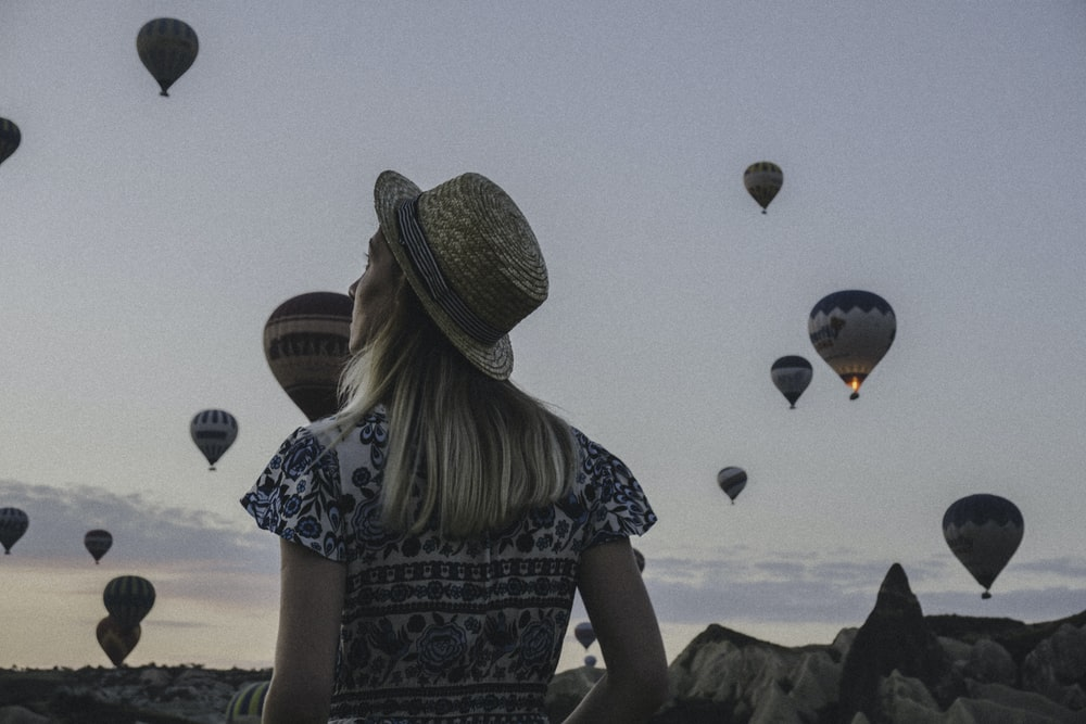 woman watching hot air balloons