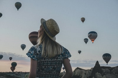 woman watching hot air balloons