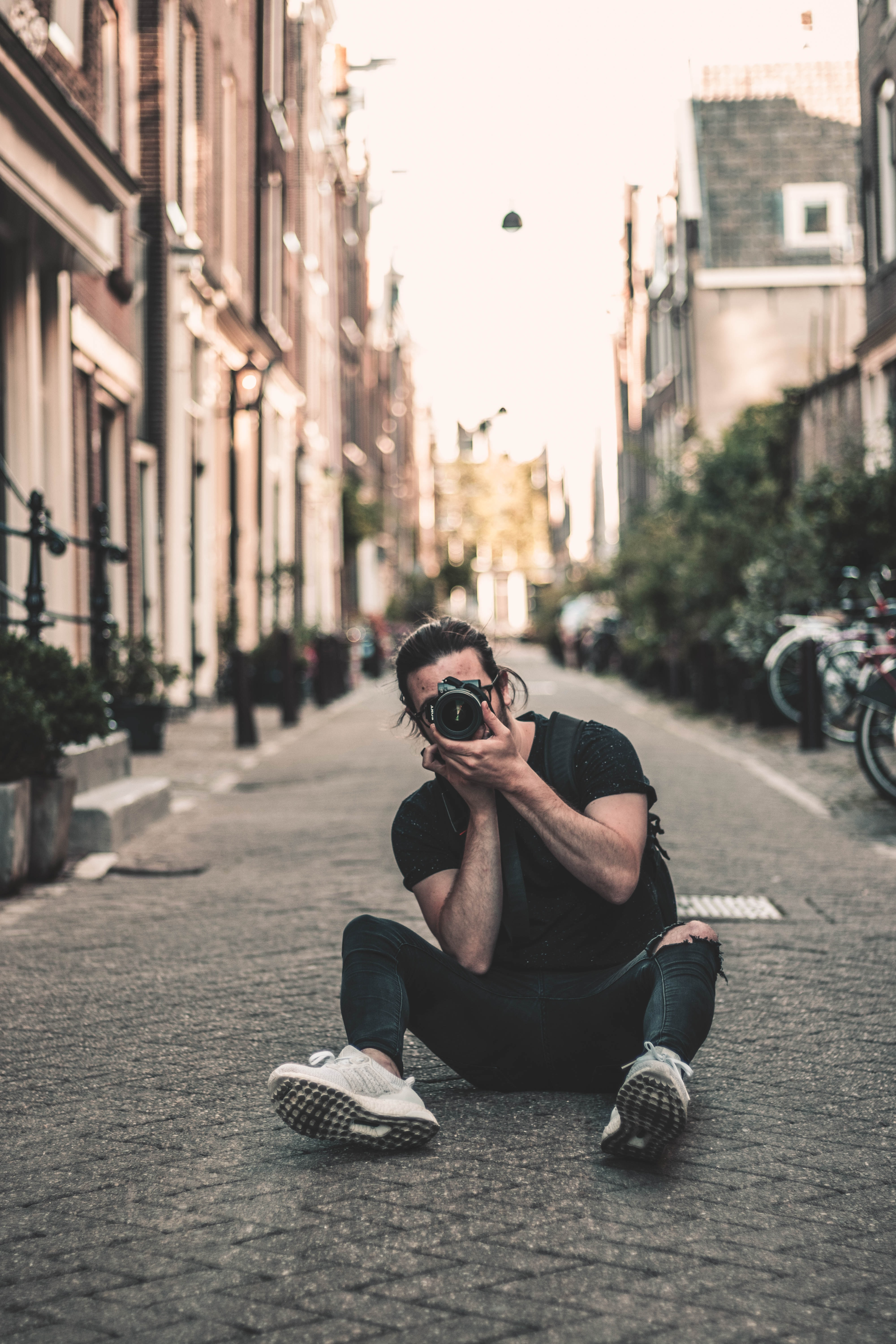 man sitting on street while talking photo