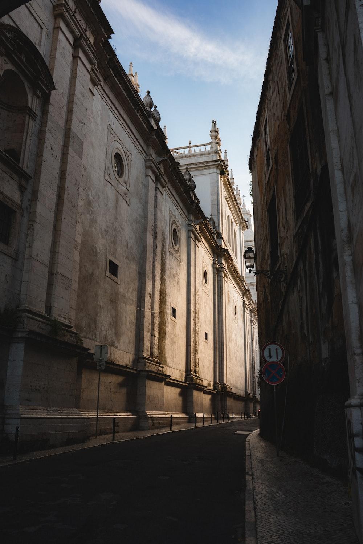 walkway between concrete building during daytime