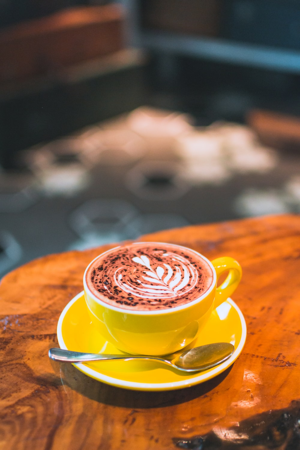 Creamy Latte Design On Yellow Coffee Mug With Saucer Photo Free Cup Image On Unsplash