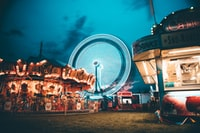 photo of brown carousel during night time