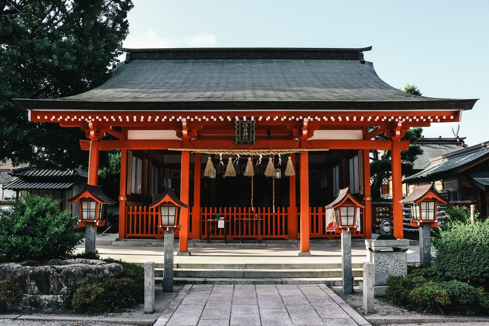 orange and black wooden temple during day