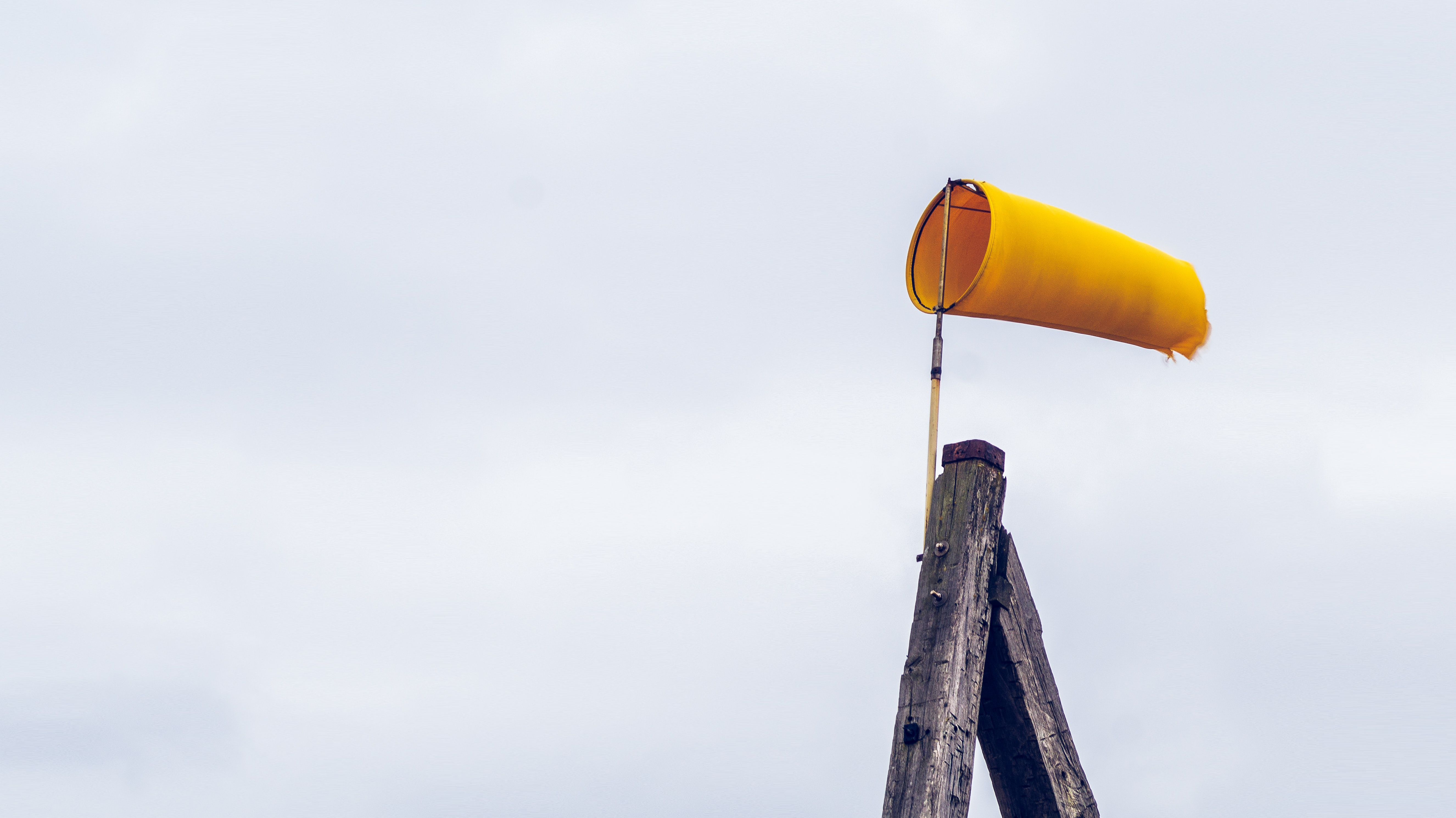 yellow air lantern on brown wooden post