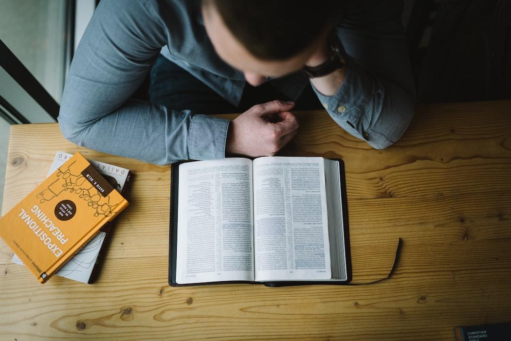 Man reading bible.