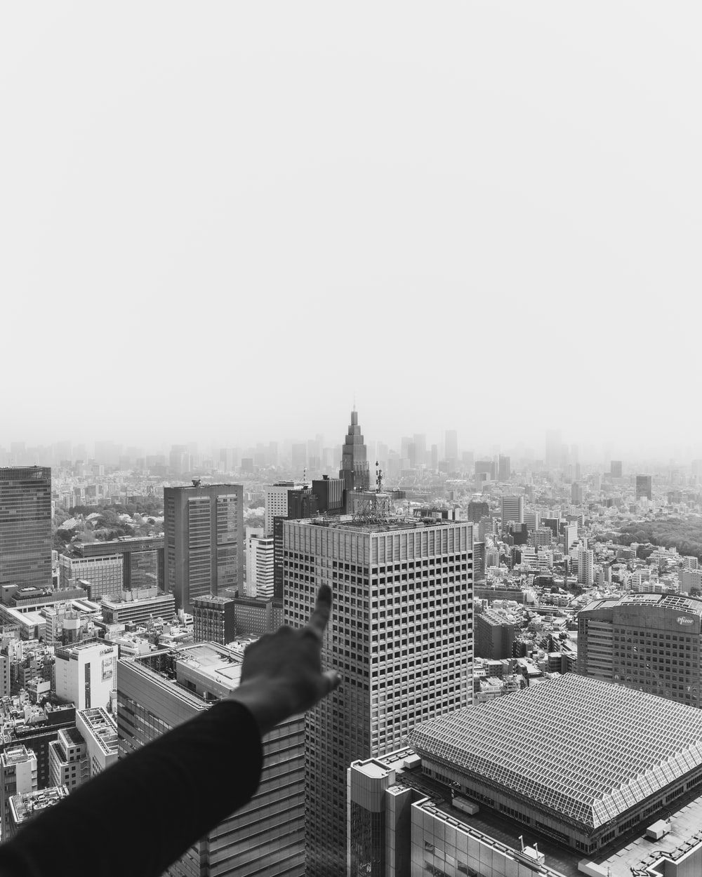 grayscale photography of person pointing Chrysler Tower, New York
