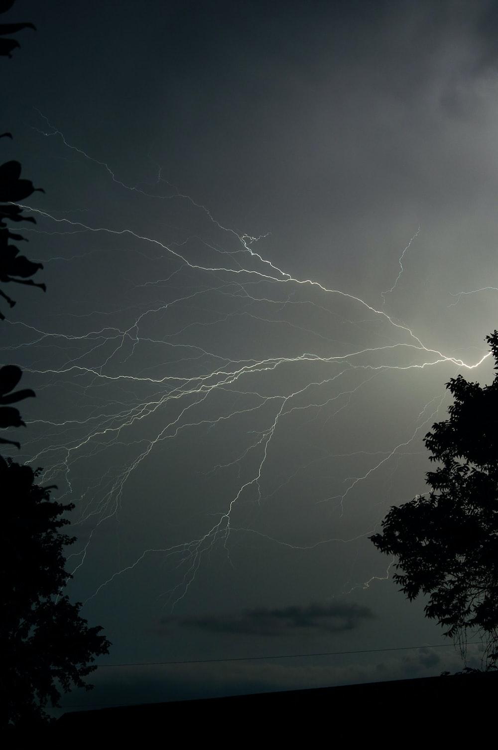 silhouette photo of lightning
