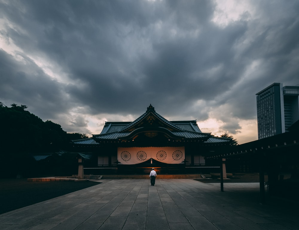 person standing in front of temple