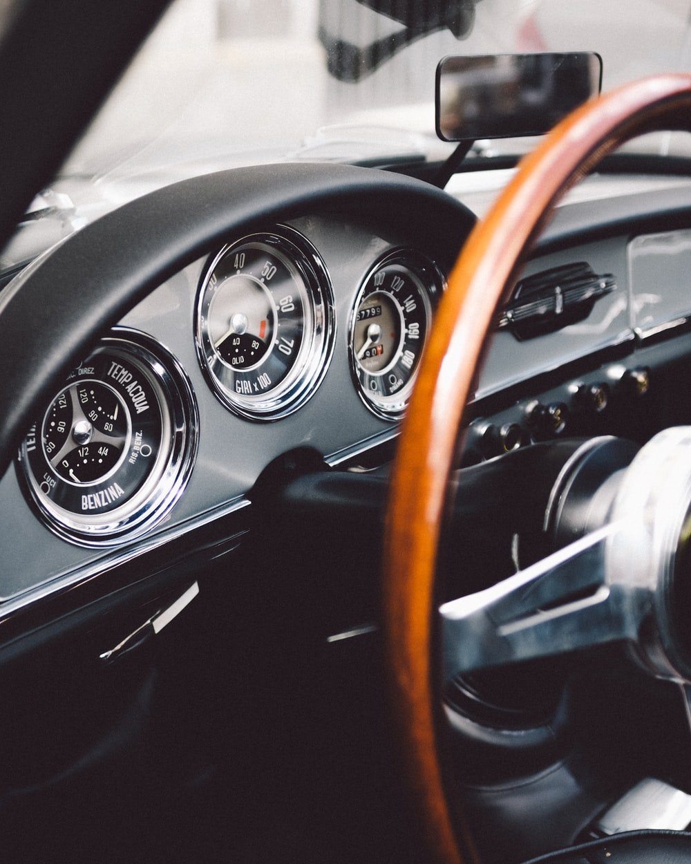 focus photography of vehicle steering wheel