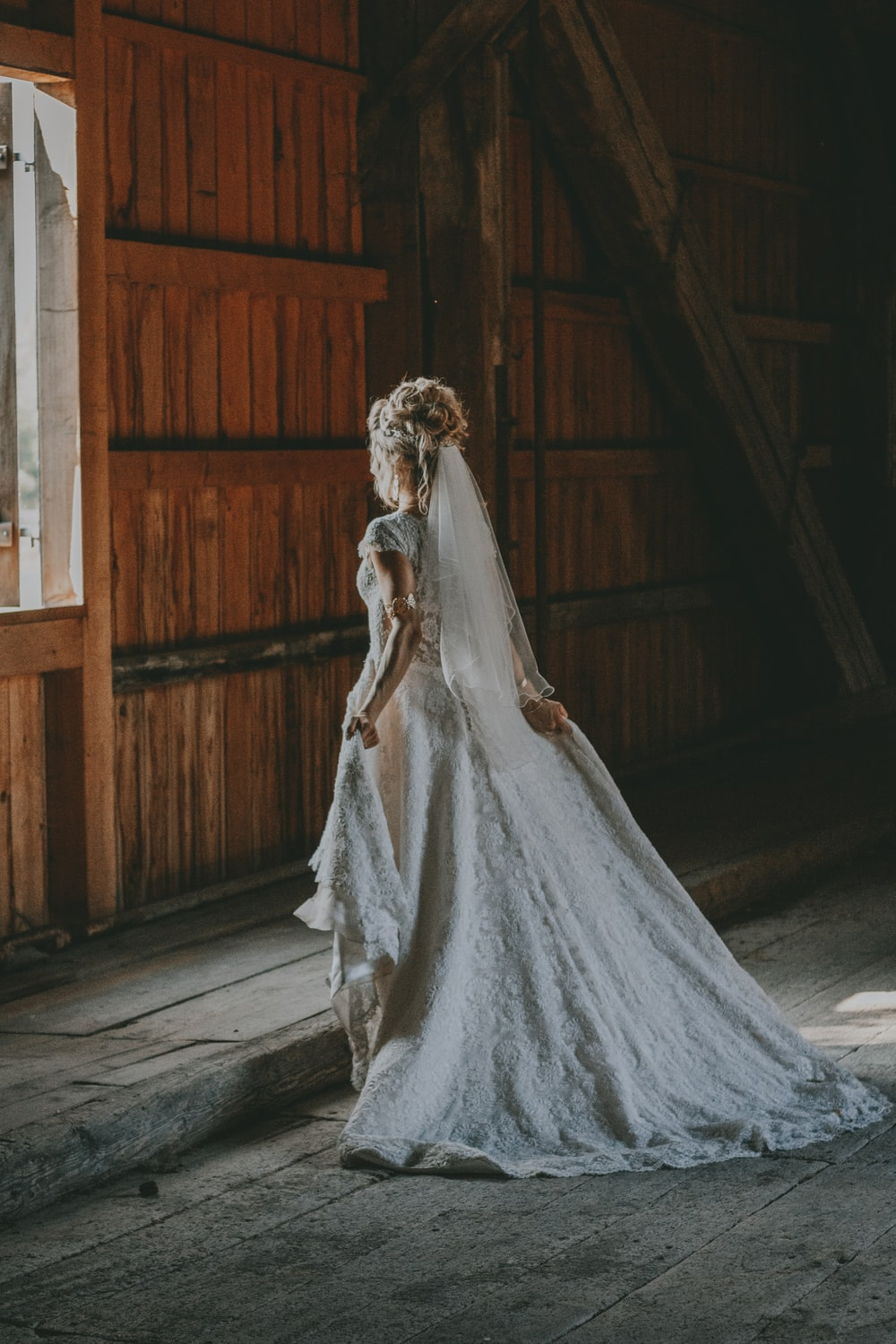 photo of woman in white wedding dress