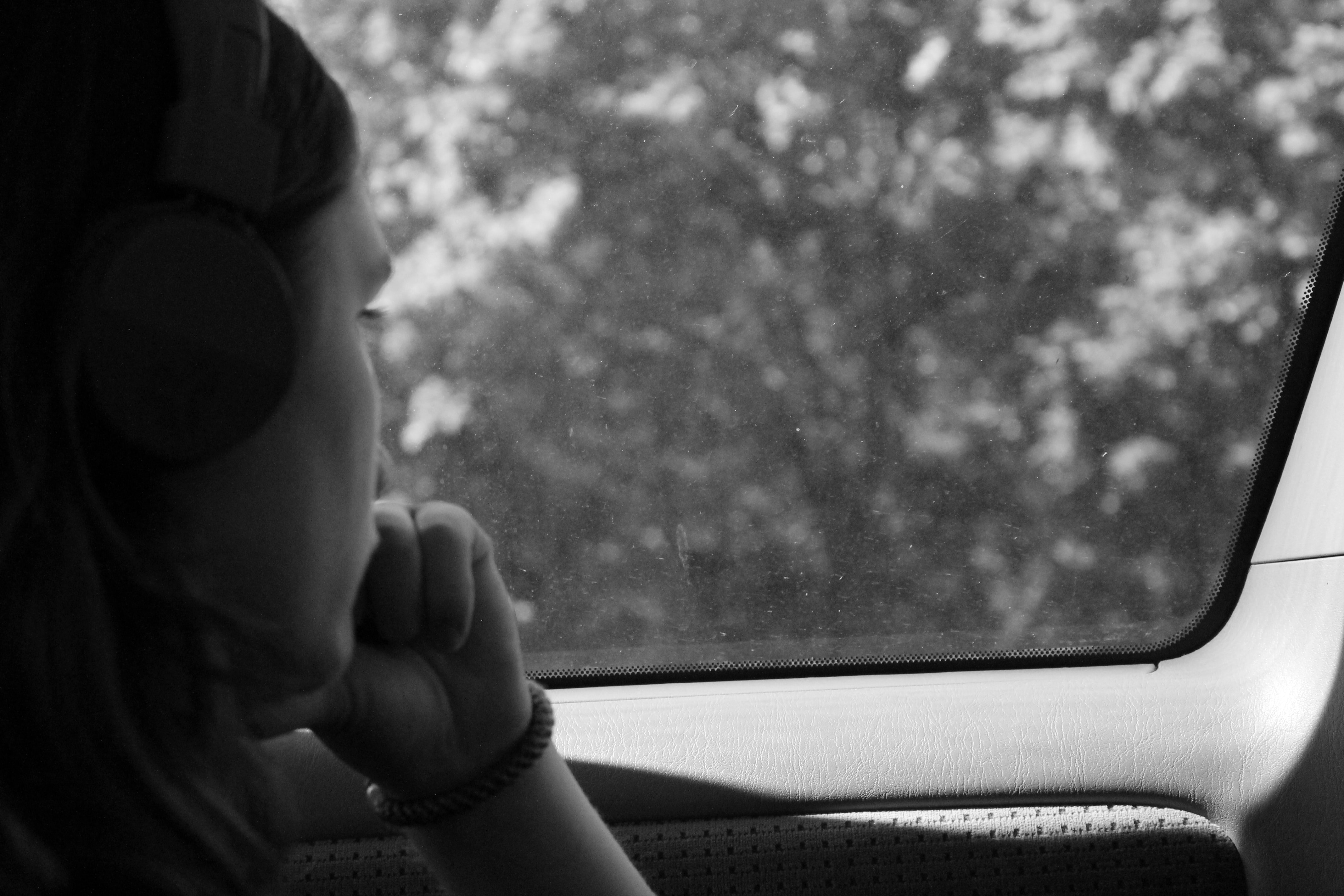 grayscale photo of woman inside car