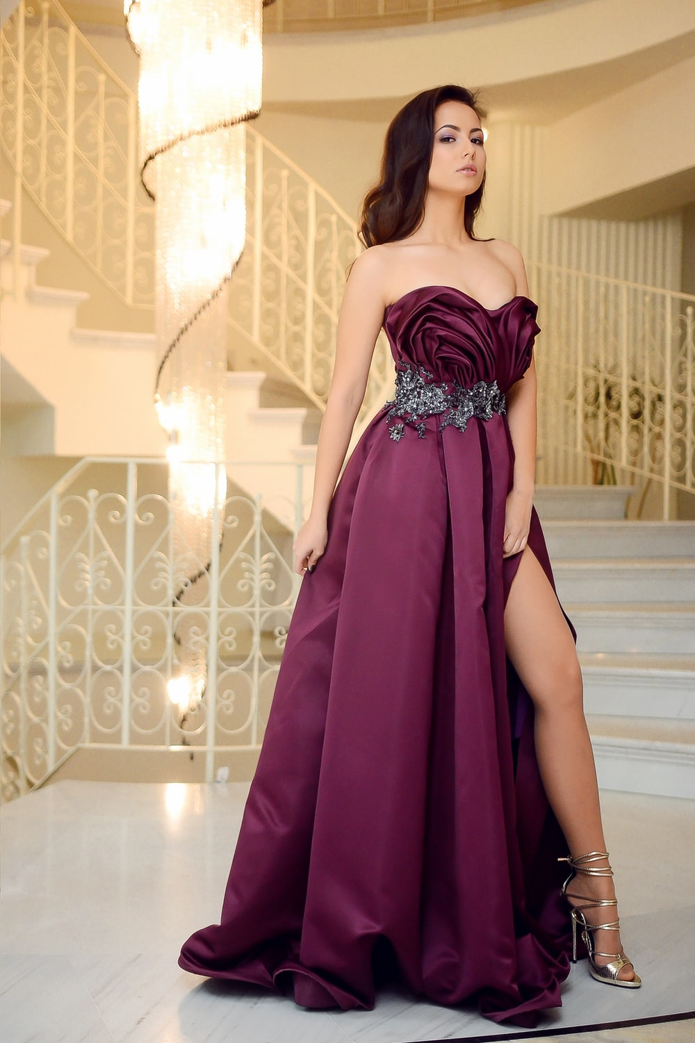 woman in maroon sweetheart gown
