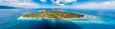 aerial photo of island under cloudy sky at daytime solomon islands zoom background