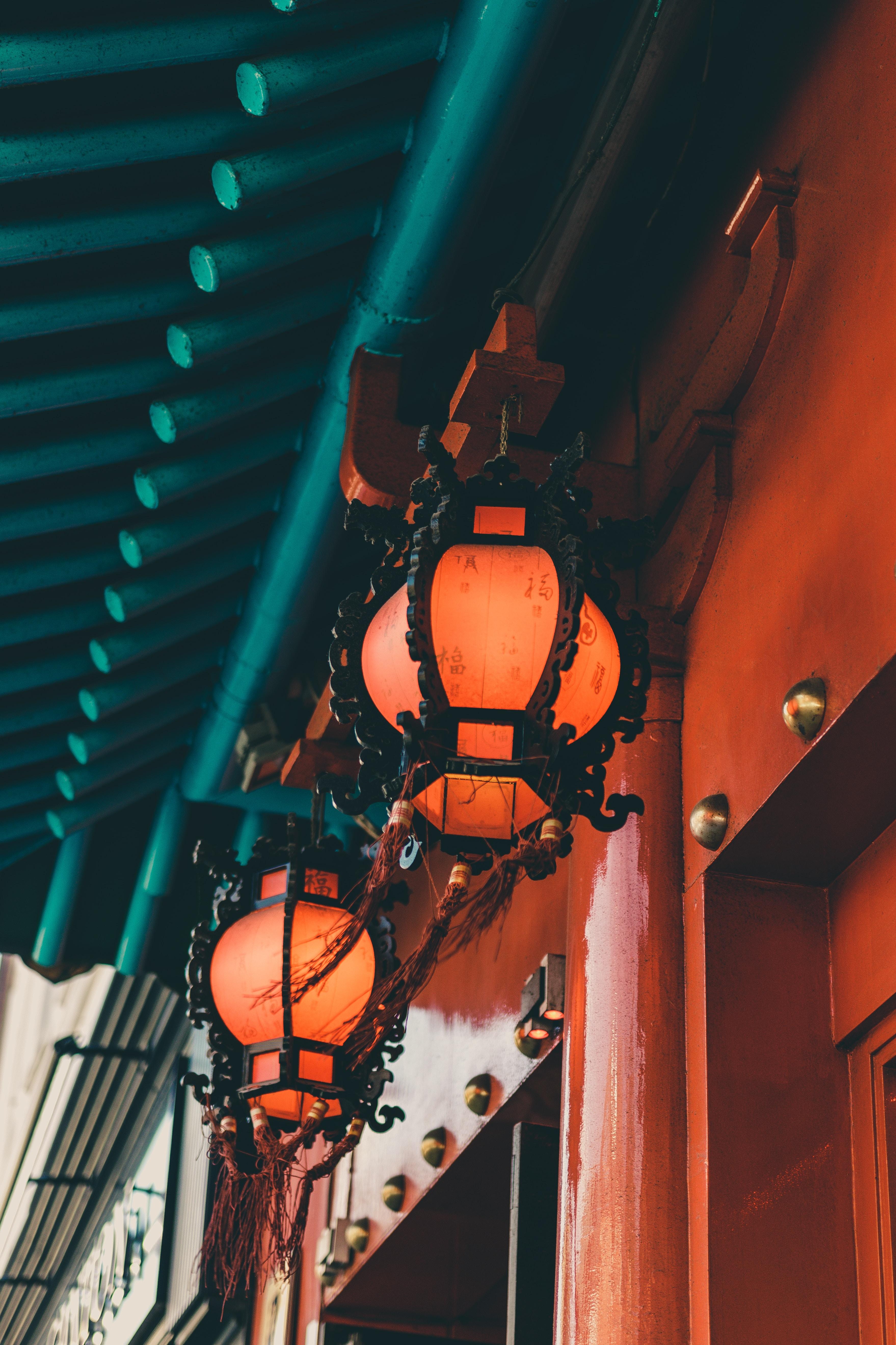two black framed lanterns