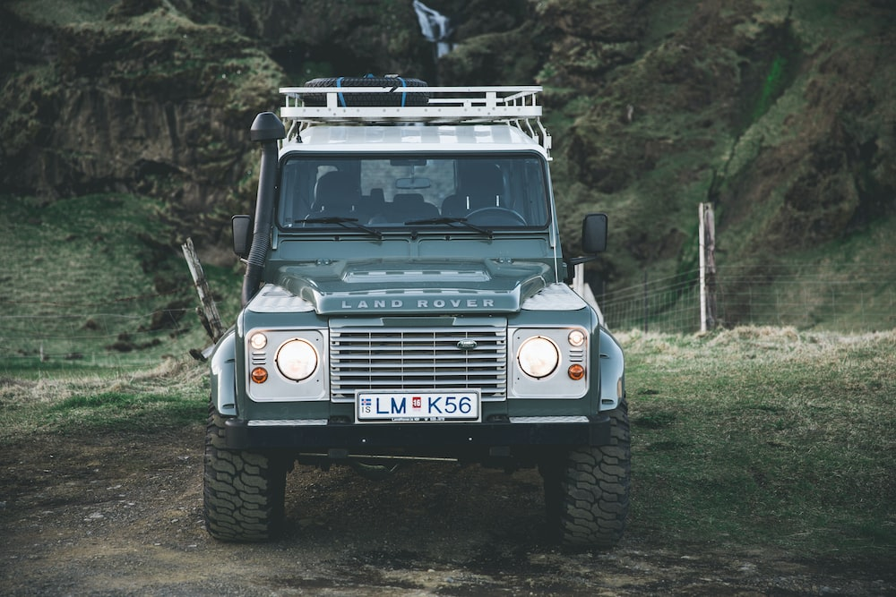 gray Land Rover vehicle parked near mountain