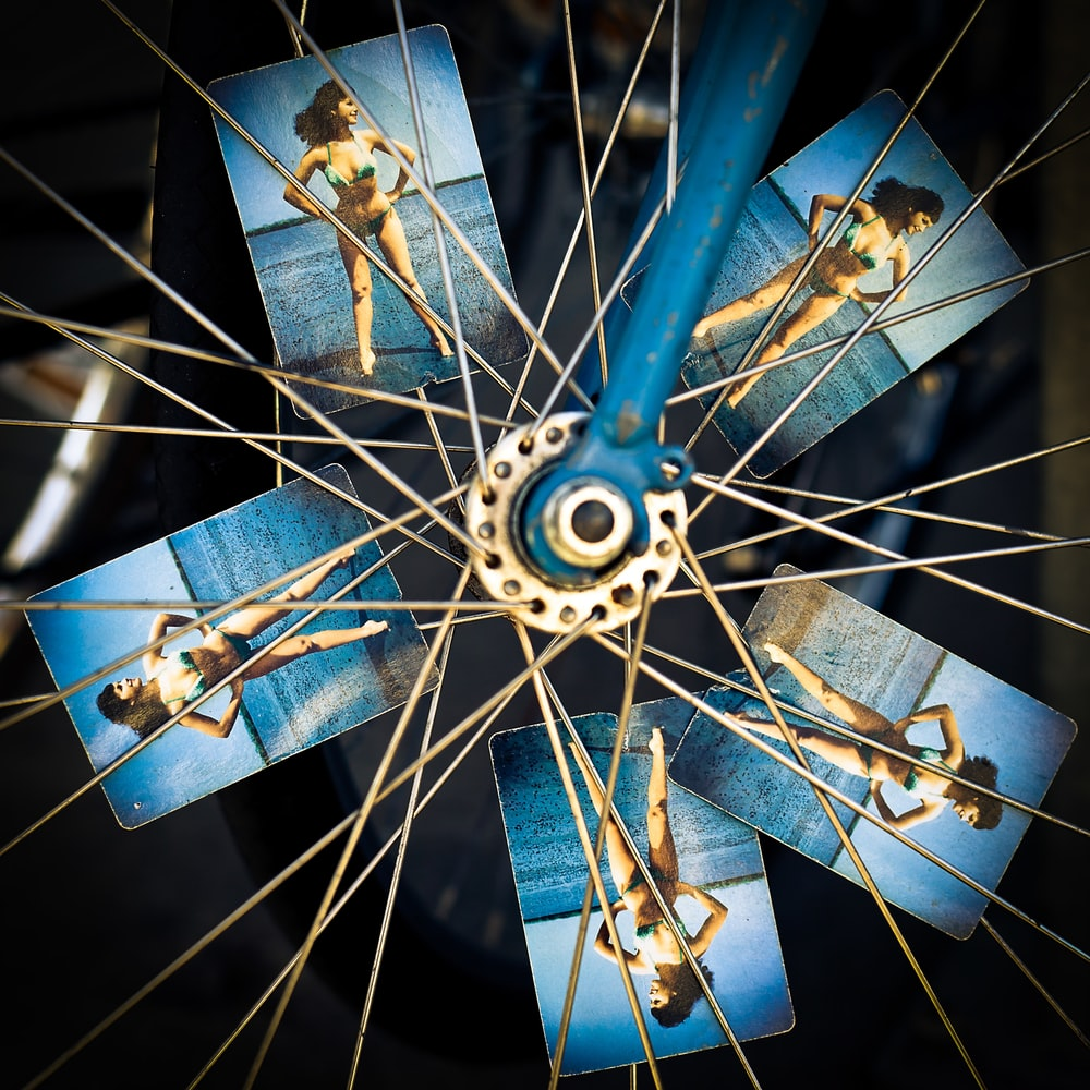 blue and grey bicycle wheel with photo of woman