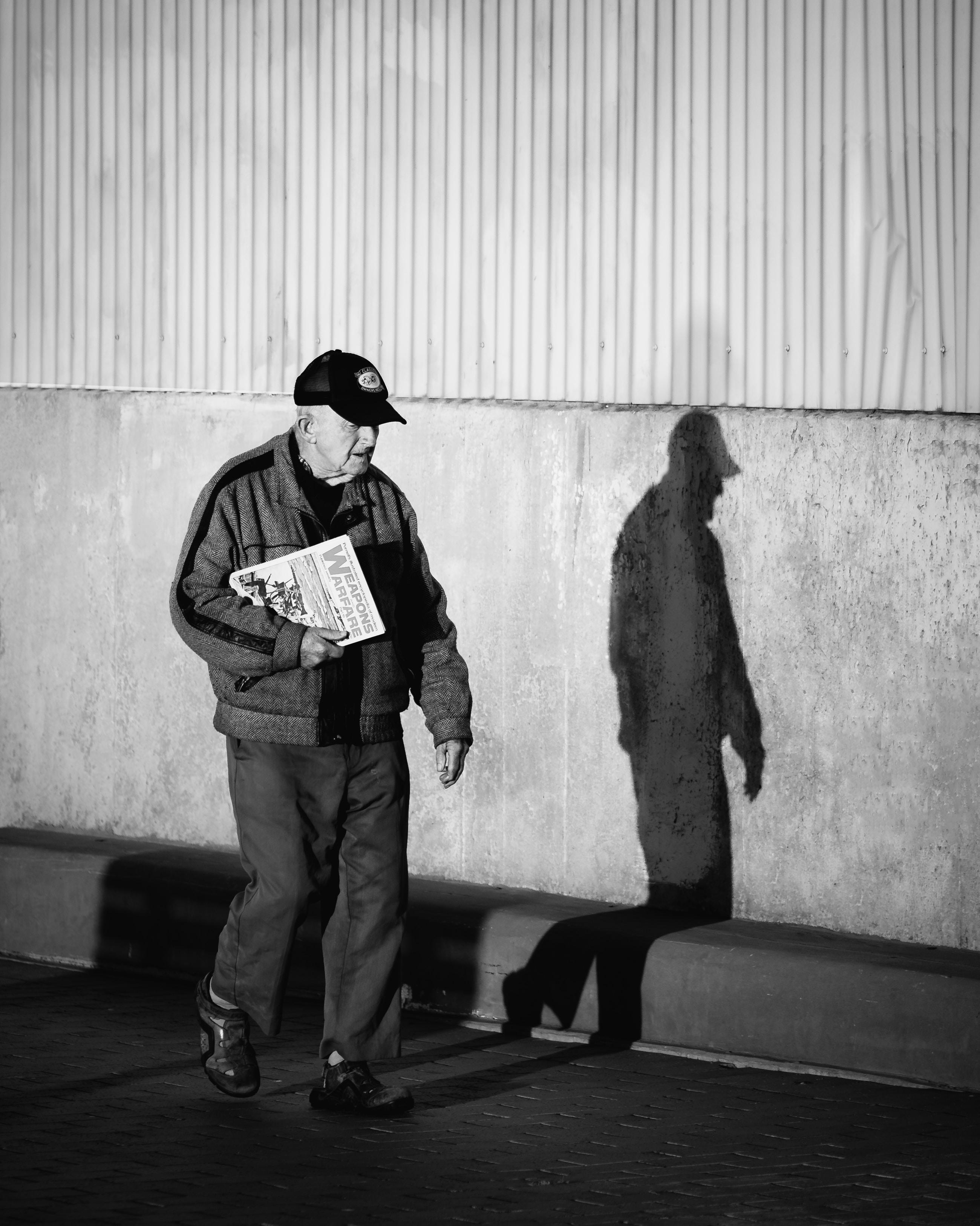 man walking on the sidewalk