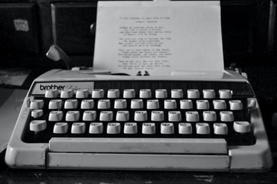 grayscale photography of brother typewriter writer teams background